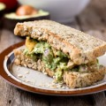 The fresh and creamy guacamole plus the warm and chewy roasted tofu compliment each other to make this sandwich a wonderful choice for lunch, dinner, or a picnic.