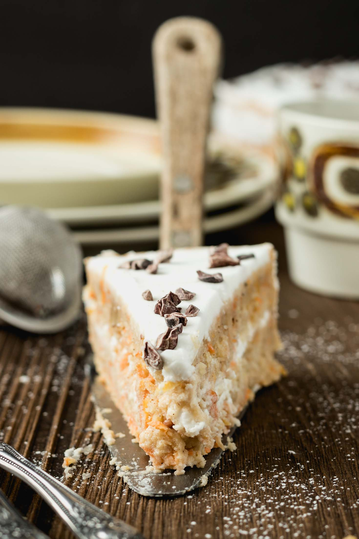 vegan Carrot Cake with Sugar-Free Coconut Cream Frosting-front view of one slice of cake on serving spatula