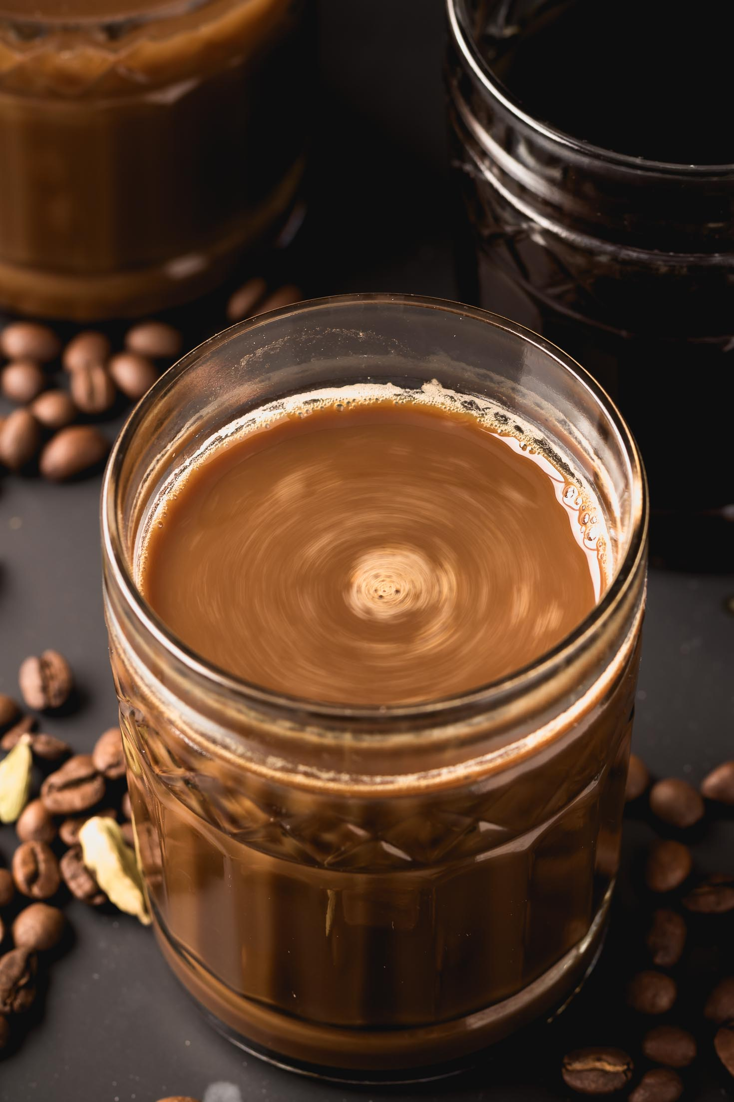 Cardamom Cold-Brewed Coffee-top view in a glass with swirling coffee