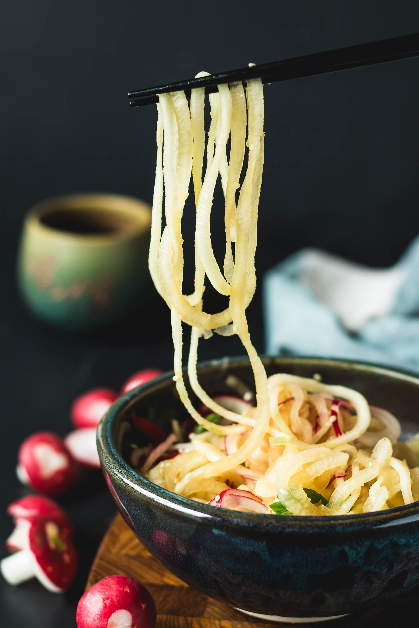 Spiralized Radish Salad-side view-on chopsticks