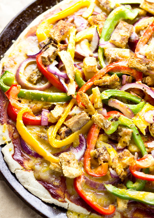 This home made cheesy vegan gluten-free pizza has a thick and chewy pizza crust. Smothered with melted vegan cheese, you won't regret not being able to order delivery pizza because of your vegan, gluten-free diet.