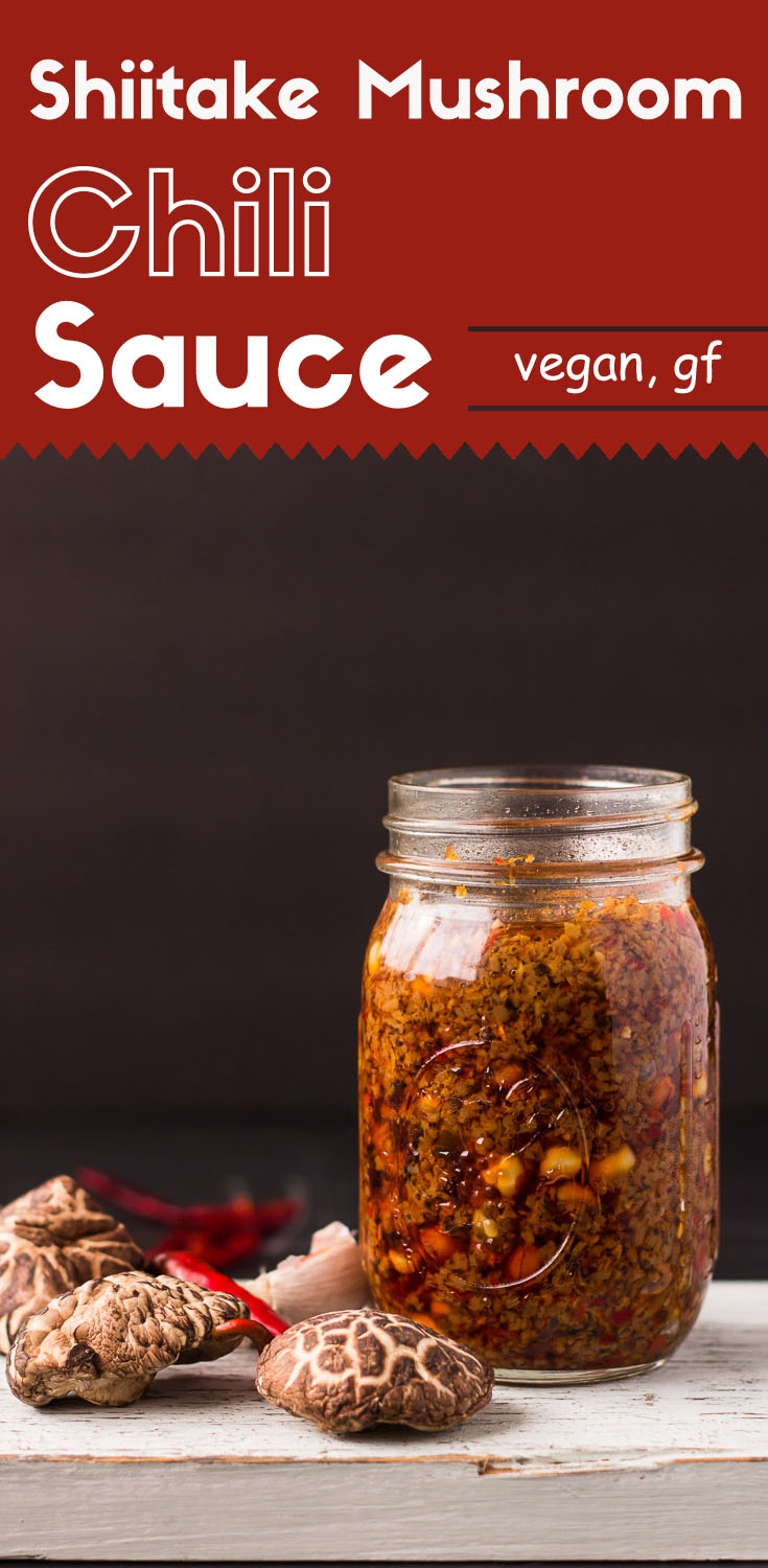 Shiitake Mushroom Chili Sauce-front view in a glass jar-red chilis and shiitake mushrooms on left side