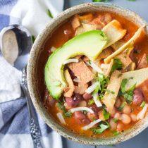 3-Bean Vegan Enchilada Soup with Baked Tortilla Strips Cilantro Avocado-Top View Square Image