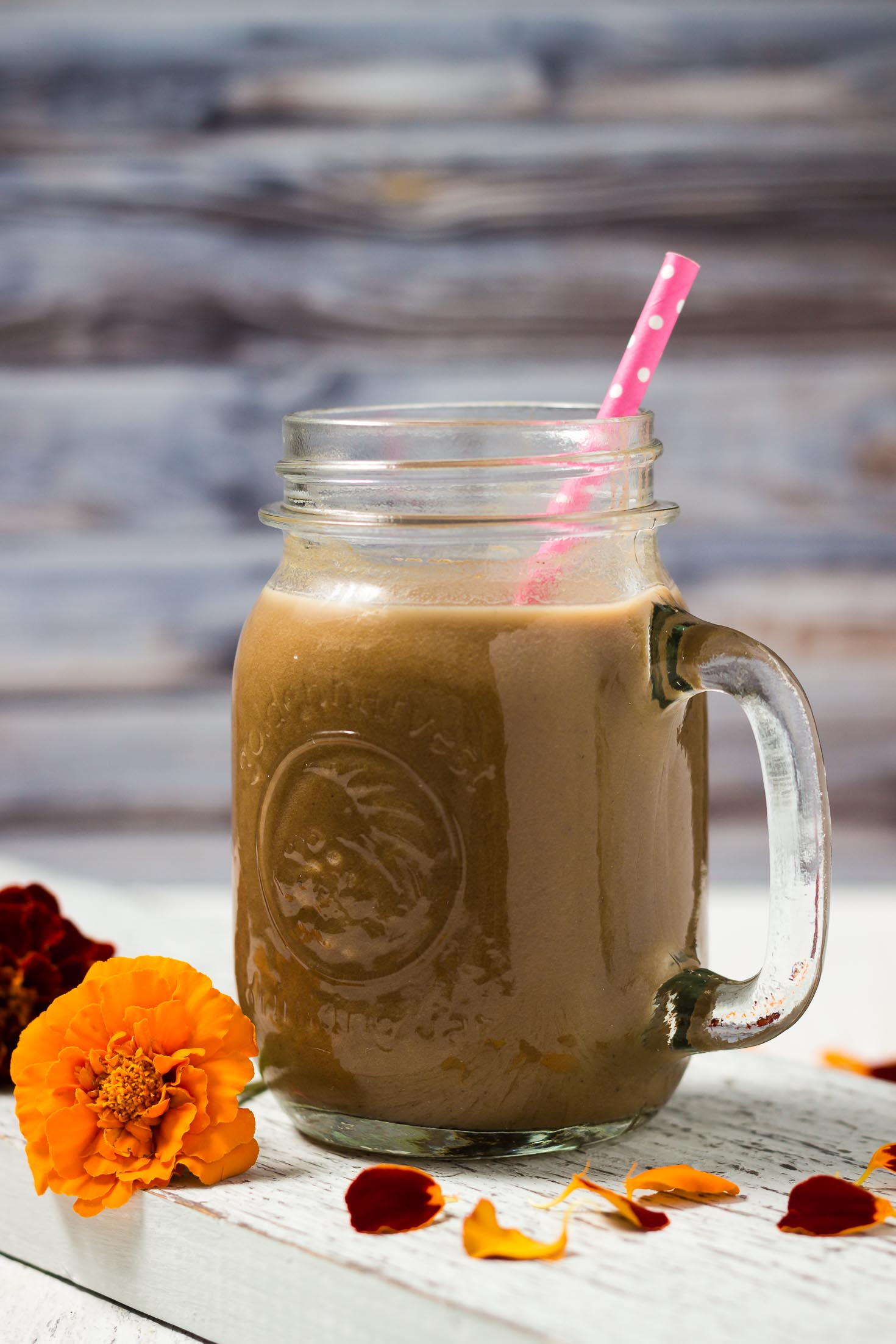 front view of pumpkin spice latte smoothie in a glass jar