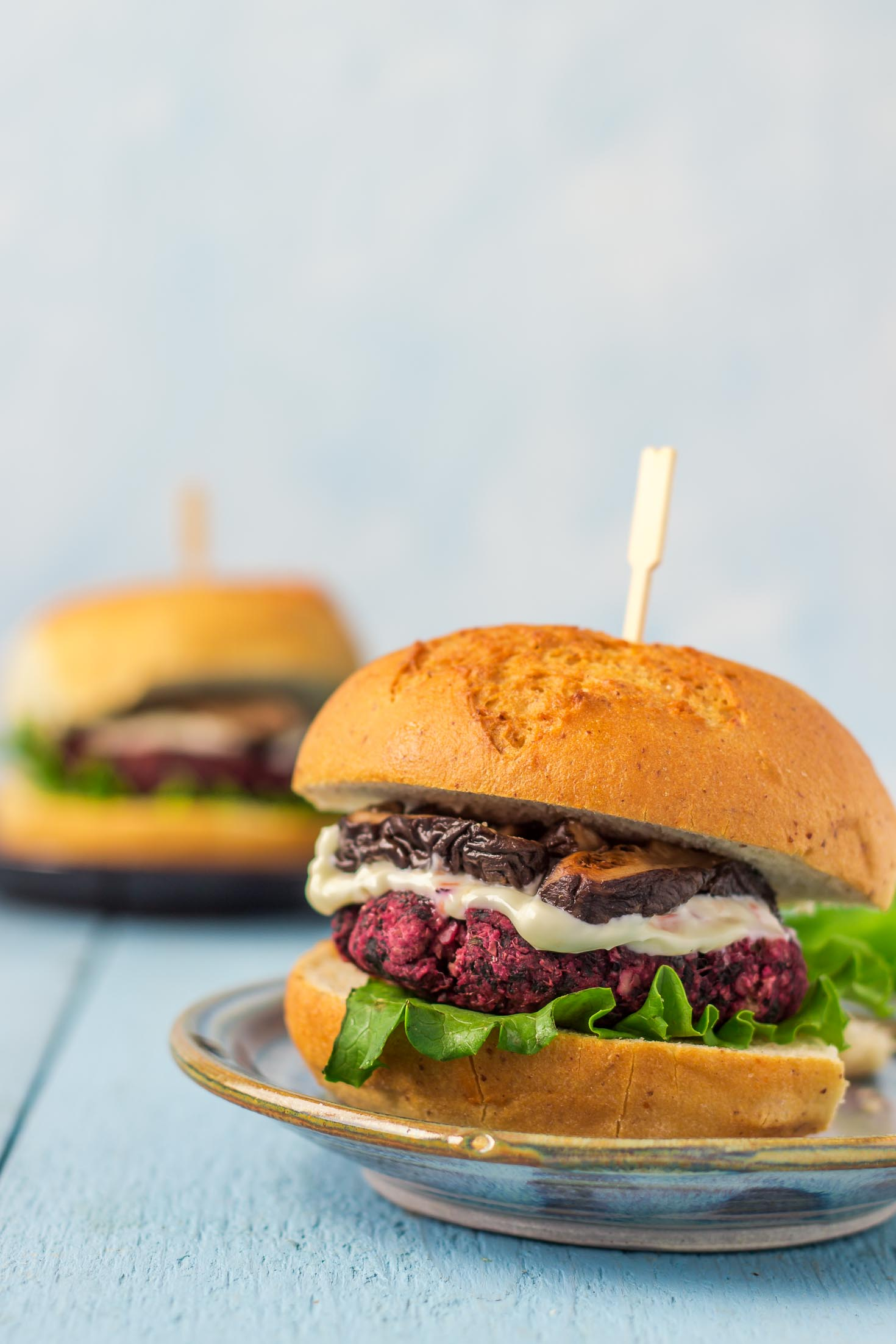 Beet Greens Lentil Burgers-assembled with green leaf lettuce, mayonnaise, soy sauce braised shiitake mushrooms between gluten-free buns