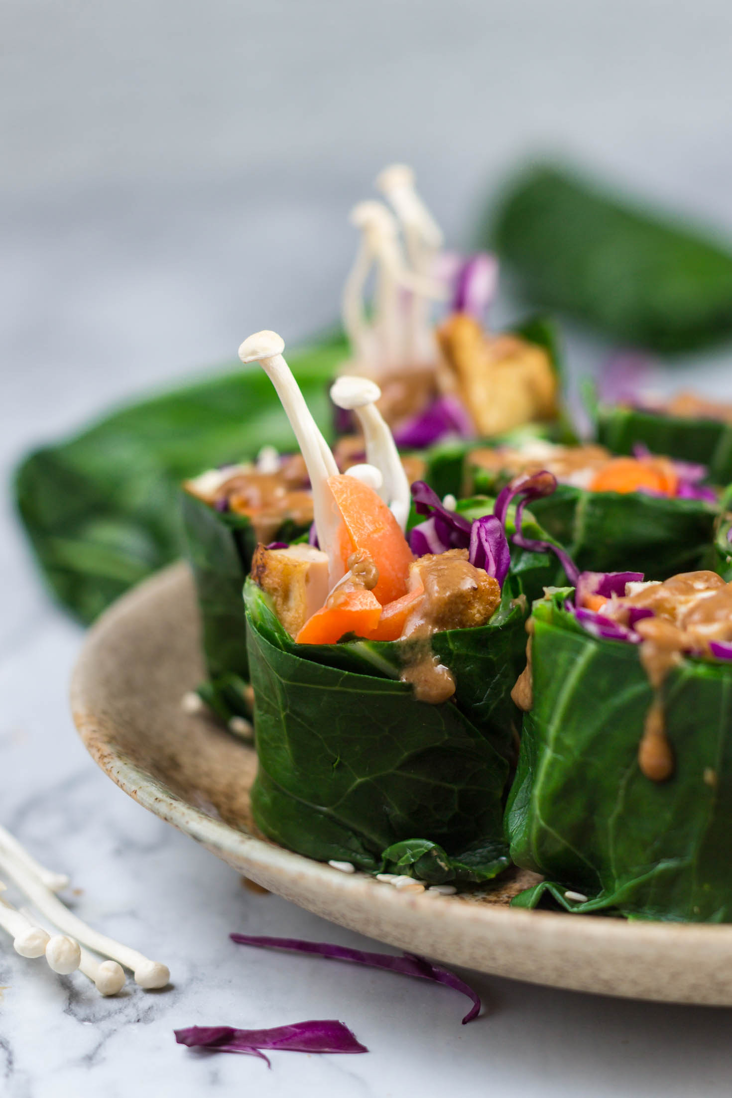 Grain-free Collard Green Rolls with Roasted Tofu and Enoki Mushrooms-side view-These grain-free collard green rolls with roasted tofu and enoki mushroom can be made any time of year.