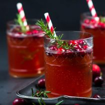 Sparkling Cranberry Rosemary Kefir Punch-side view square image-3 glasses with rosemary sprigs and cranberries.
