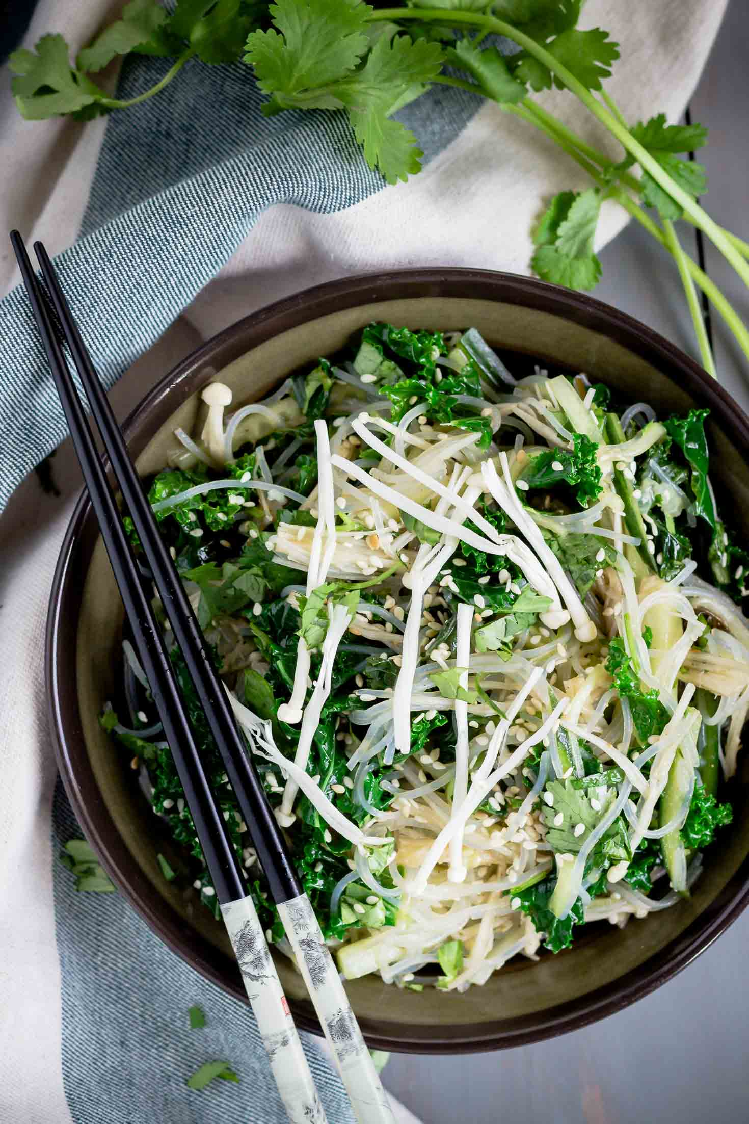 Chive Oil Glass Noodle Kale Salad-topview in a blow with chopsticks