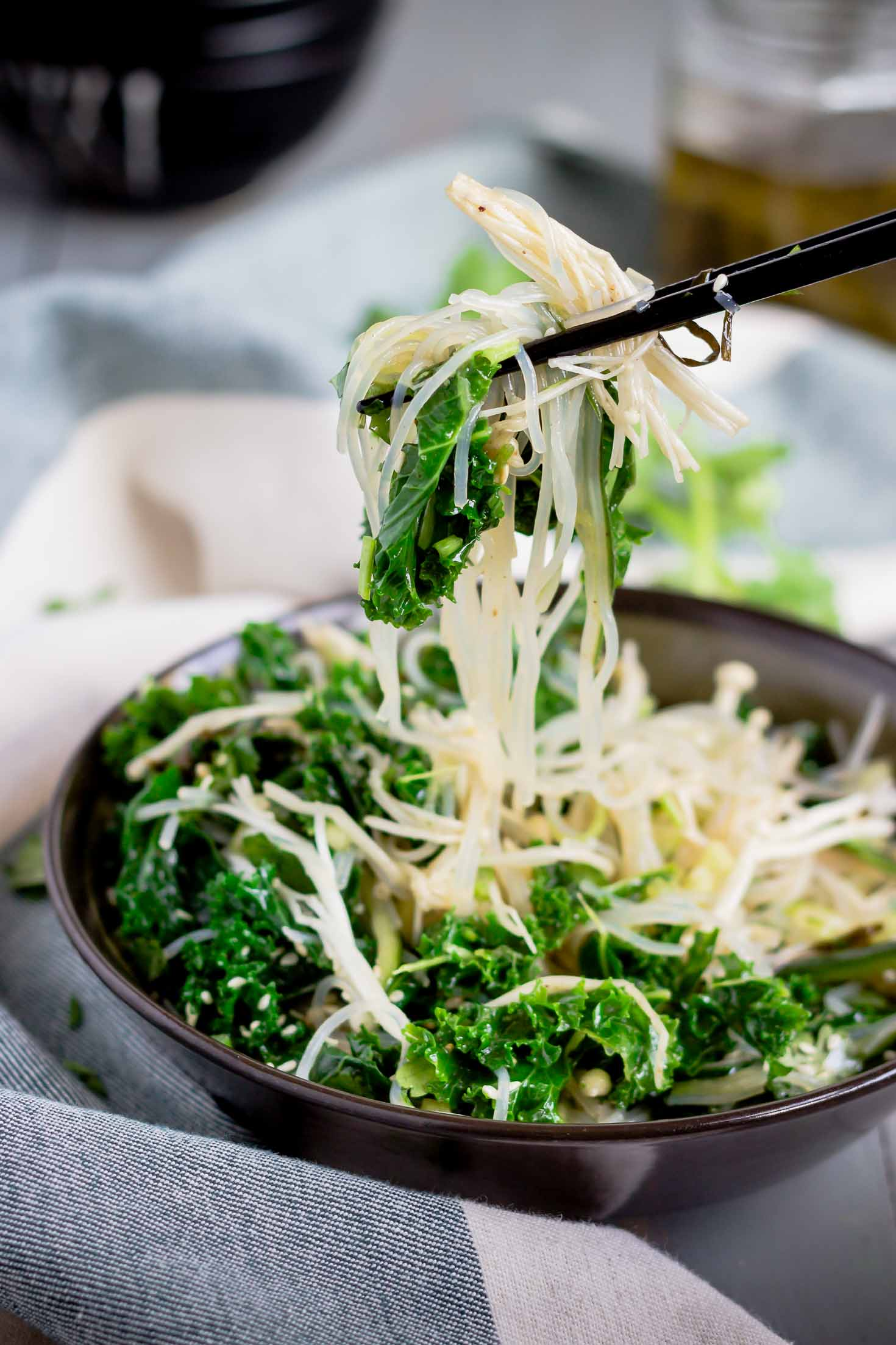 Chive Oil Glass Noodle Kale Salad-sideview-served with chopsticks