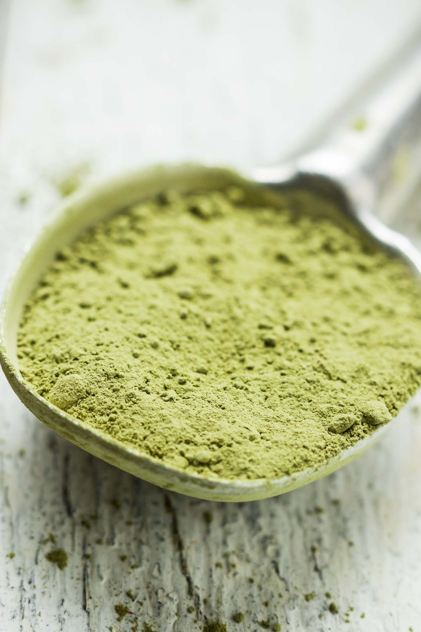 Green Kiwi Matcha Protein Smoothie-closeup view-matcha powder in a tablespoon