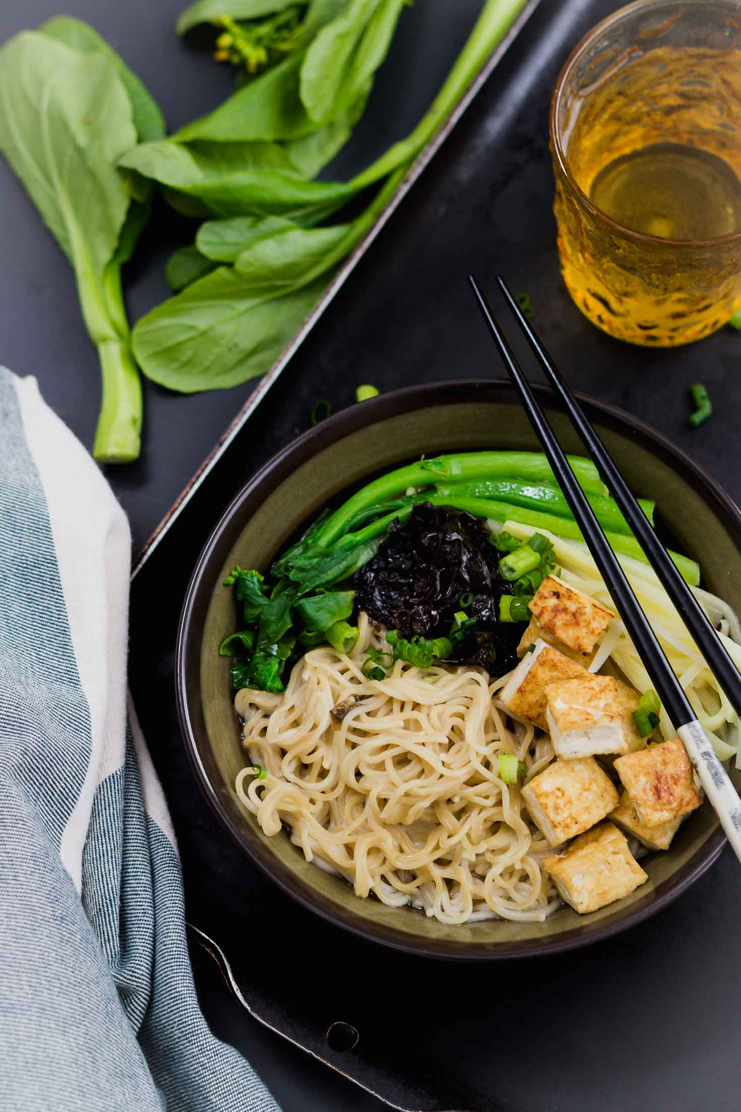 One-Pot Miso Tofu Gluten-free Ramen-top view-in a bowl with green vegetables