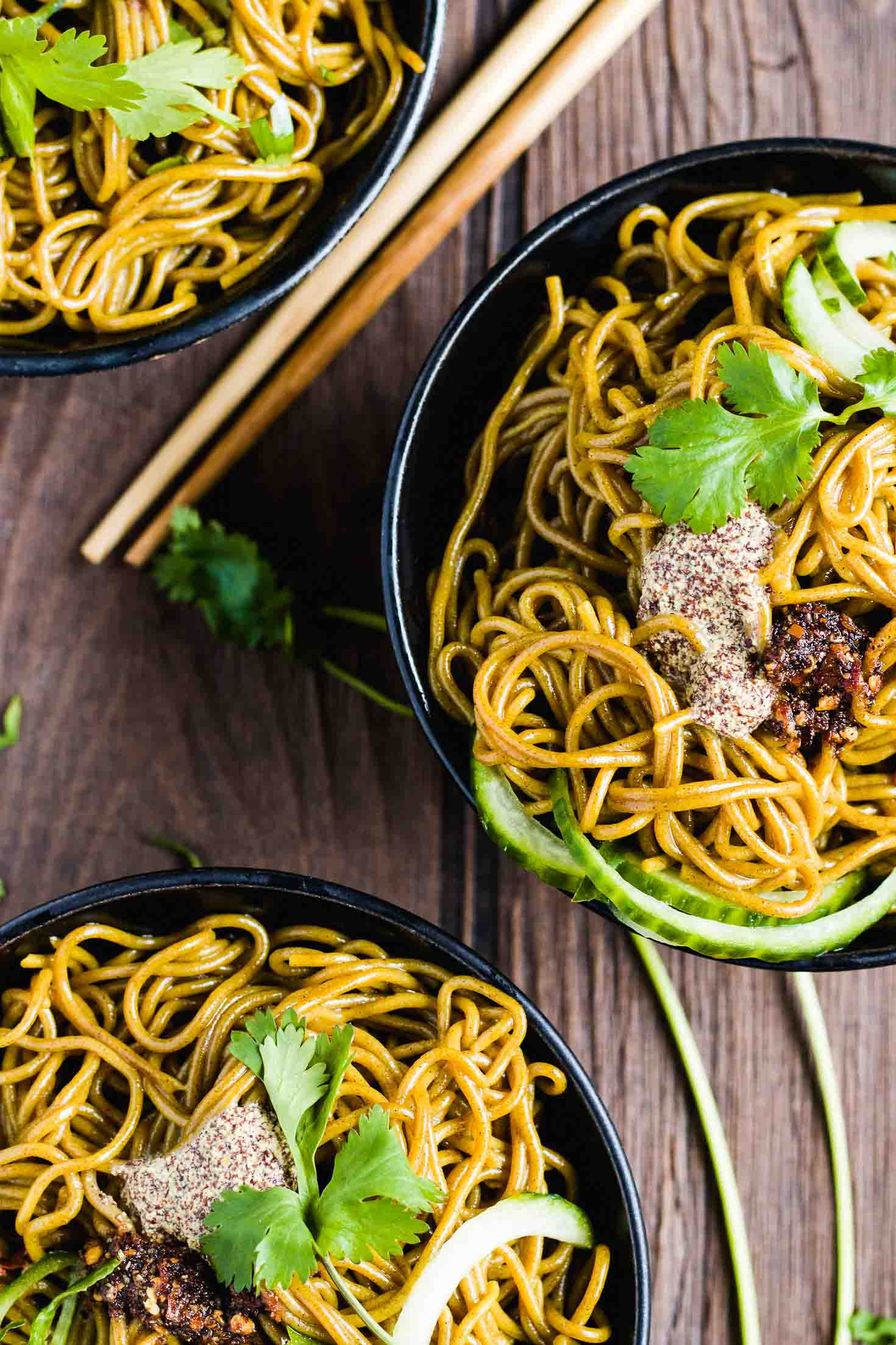 Mustard Past Buckwheat Noodle Salad-topview-in three bowls-garnished with cilantro leaves