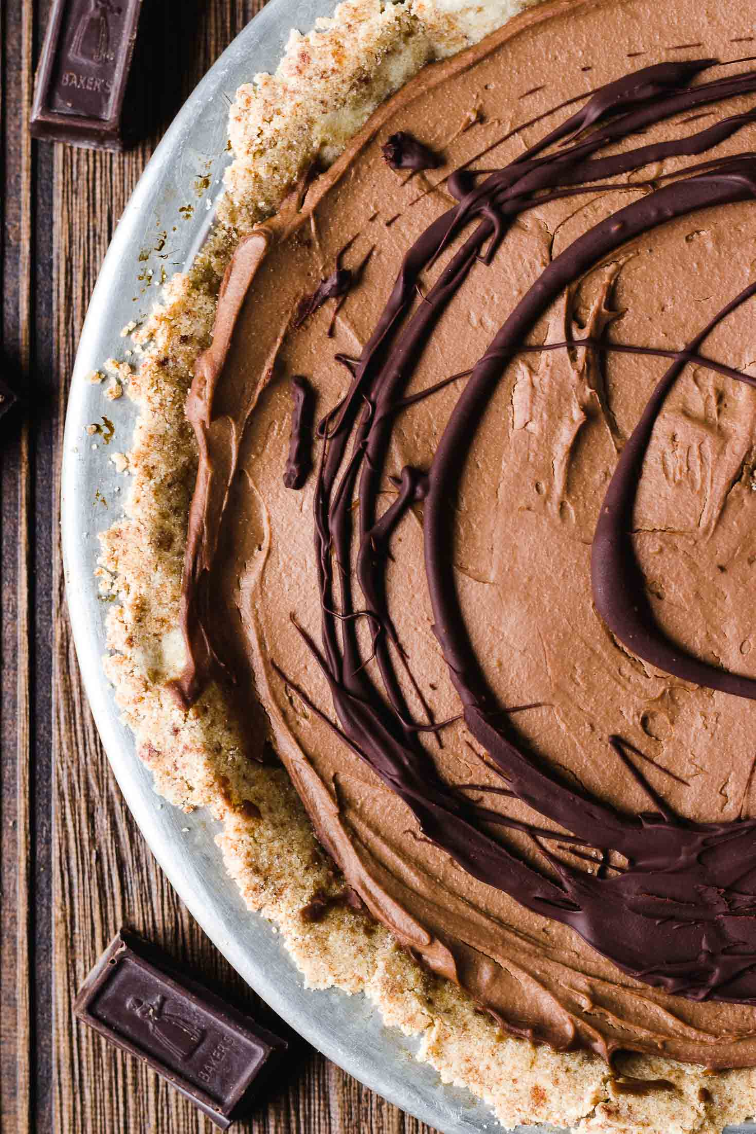 Vegan Cashew Butter Silky Chocolate Pie-top view-pie in a pie pan with melted chocolate garnishing