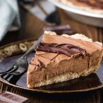 Vegan Cashew Butter Silky Chocolate Pie-small square image-a piece of pie on a brown plate