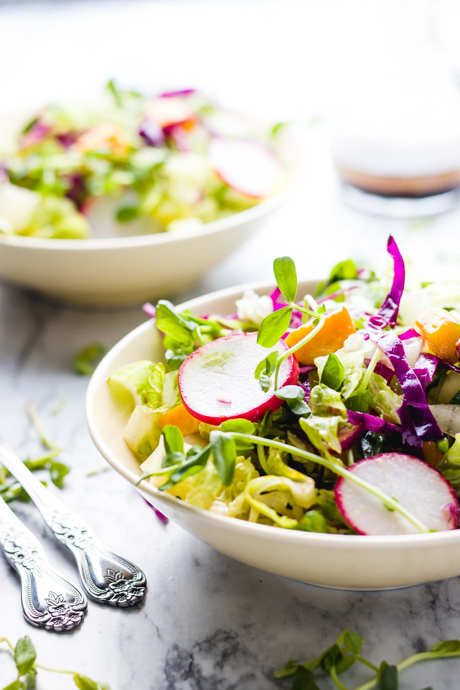 Pea shoots mango rainbow salad-front view-Salad is served in a bowl with balsamic vinargrette. #vegan #salad #peashoot #microgreensalad