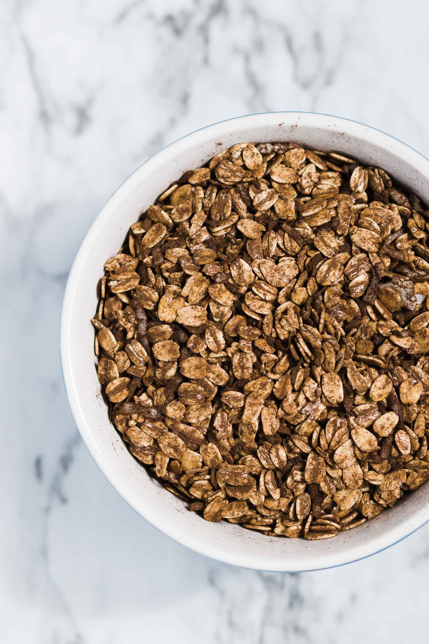 Pistachio Chocolate Granola-top view-rolled oats mixed with cocoa powder