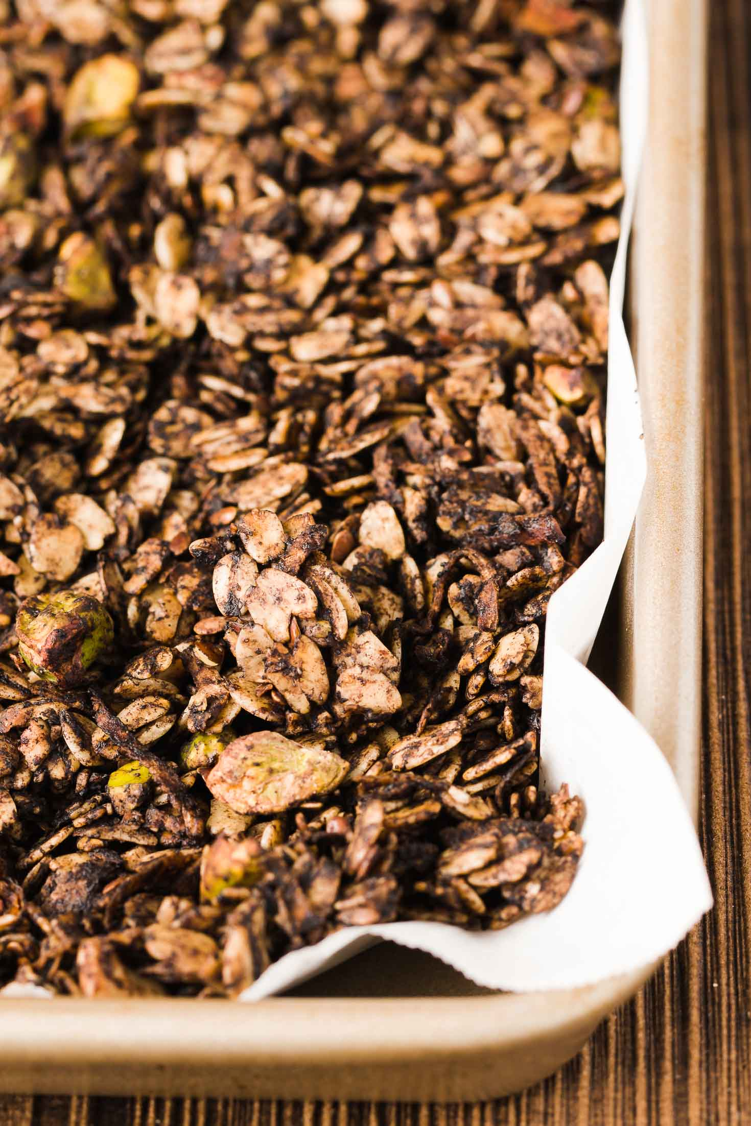 Pistachio Chocolate Granola-front view-granola in a baking tray